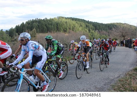 VERNON, FRANCE - MAR 01: Kevin Reza, Europcar, in peloton pack riding La Classic Sud Ardeche UCI Europe Tour Pro Race on March 01, 2014 in Versas Hill, Ardeche, France. Florian Vachon won the race.