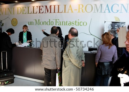 VERONA - APRIL 08: People ask for information at Emilia Romagna pavilion recipetion, Vinitaly, international wine and spirits exhibition April 08, 2010 in Verona, Italy.