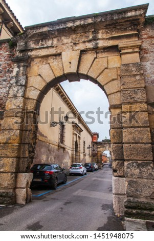 Verona, Italy, on April 24, 2019. the picturesque street with a stone arch and a traditional architectural complex in the old city.  #1451948075