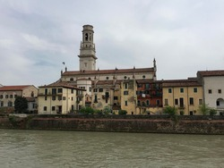 VERONA, ITALY. Verona cathedral view from Borgo Trento. River Adige. Riverside and old terracotta buildings around. Date of photo is 02.05.2018