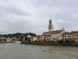 VERONA, ITALY. Verona cathedral view from Borgo Trento. River Adige. Riverside and old terracotta buildings around, Castel San Pietro on the hill surrounded by cypress trees. Date of photo is 02.05.18