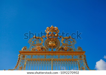 Versailles chateau. France. View of golden gate to palace. Royal residence near Paris. King's quarters. Famous touristic renaissance architecture landmark in summe #1092270902