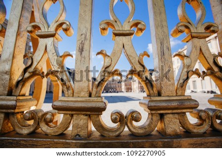 Versailles chateau. France. View of golden gate to palace. Royal residence near Paris. King's quarters. Famous touristic renaissance architecture landmark in summe #1092270905