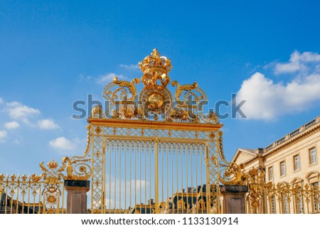 Versailles chateau. France. View of golden gate to palace. Royal residence near Paris. King's quarters. Famous touristic renaissance architecture landmark in summe #1133130914