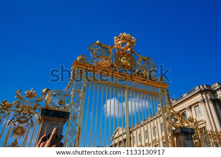 Versailles chateau. France. View of golden gate to palace. Royal residence near Paris. King's quarters. Famous touristic renaissance architecture landmark in summe #1133130917
