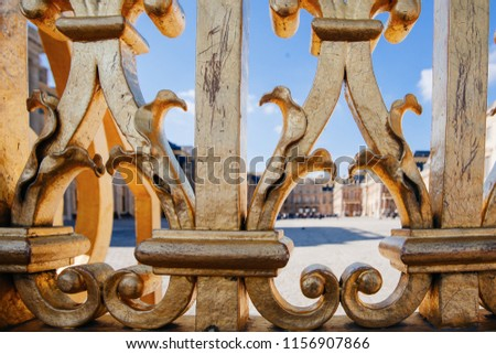 Versailles chateau. France. View of golden gate to palace. Royal residence near Paris. King's quarters. Famous touristic renaissance architecture landmark in summe #1156907866