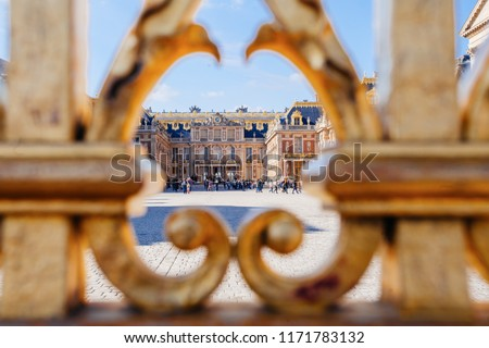 Versailles chateau. France. View of golden gate to palace. Royal residence near Paris. King's quarters. Famous touristic renaissance architecture landmark in summe #1171783132