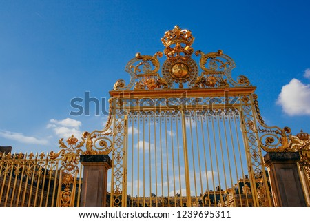 Versailles chateau. France. View of golden gate to palace. Royal residence near Paris. King's quarters. Famous touristic renaissance architecture landmark in summe #1239695311