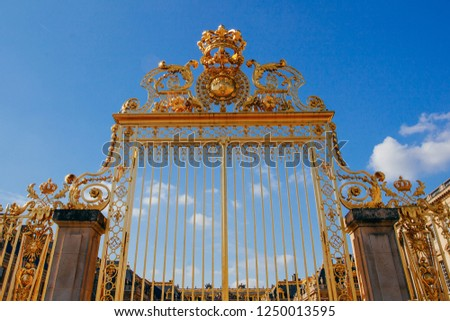 Versailles chateau. France. View of golden gate to palace. Royal residence near Paris. King's quarters. Famous touristic renaissance architecture landmark in summe #1250013595