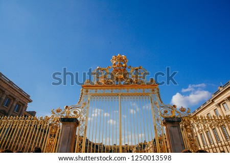 Versailles chateau. France. View of golden gate to palace. Royal residence near Paris. King's quarters. Famous touristic renaissance architecture landmark in summe #1250013598