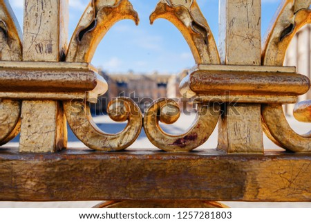 Versailles chateau. France. View of golden gate to palace. Royal residence near Paris. King's quarters. Famous touristic renaissance architecture landmark in summe #1257281803
