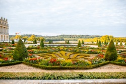 Versailles garden with beautiful sculptures, vases and trimmed bushes in Versaillle palace in France