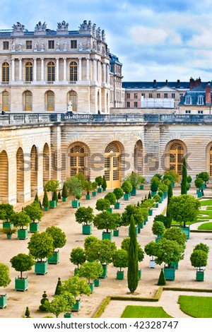 Versailles Palace exterior near Paris, France. This view shows the Orangerie with citrus fruit trees.