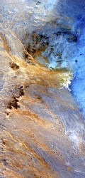 vertical abstract photography of the deserts of Africa from the air, aerial view of desert landscapes, Genre: Abstract Naturalism, from the abstract to the figurative,