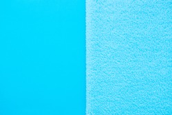 Vertical Background of two types of blue fabric - smooth and fluffy. Baby blue Soft fabric pastel textile texture. Gentle Blue towel terry cloth