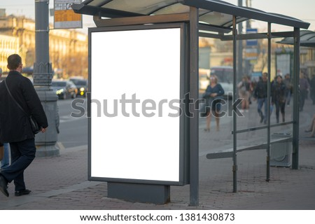 Vertical billboard lightbox in the city advertising in the bus shelter. for placing the MOCKUP advertisement with people in the background #1381430873