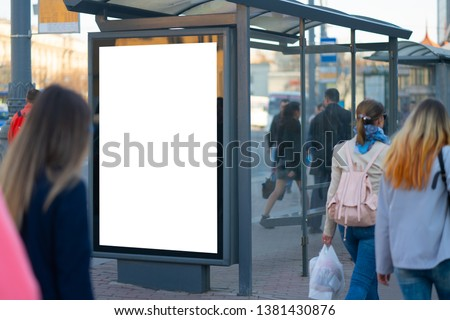 Vertical billboard lightbox in the city. for placing the MOCKUP advertisement with people in the background advertising in the bus shelter #1381430876