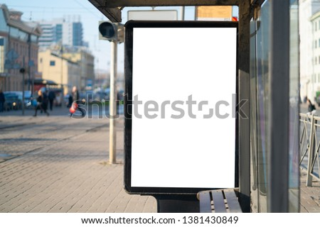 Vertical billboard Outdoor Advertising in the city. for placing the MOCKUP advertisement advertising in the bus shelter. #1381430849