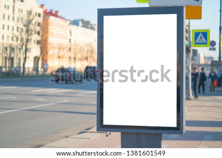 Vertical billboard Outdoor Advertising lightbox in the city. for placing the MOCKUP advertisement