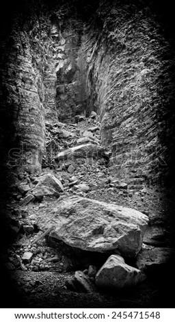 Vertical black and white landslide rock landscape