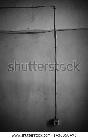 Vertical black and white wall with electirc outlet plug background hd