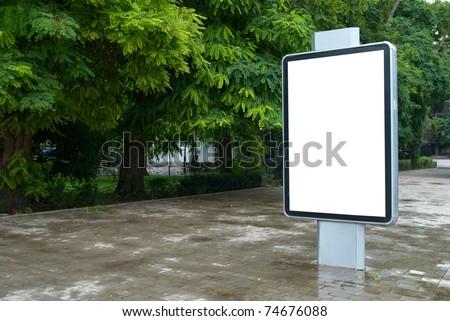 Vertical blank billboard on the city street