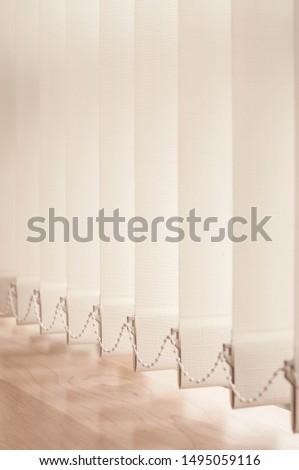 Vertical blinds in brown tone. Vertical blinds.