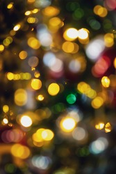 Vertical Blurry bokeh colouful lights at night. Abstract of multicolored ligh  from Christmas tree on dark blue background, Christmas or Holiday concept.