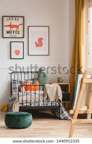 Vertical capture of genderless cozy bedroom in elegant tenement house