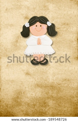 vertical card first communion, funny brunette girl in parchment background