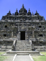 Vertical Close up Portrait of Beautiful Plaosan Temple Candi, Klaten, Central Java, Indonesia stone rocks stairs scenery blue sky. historical landmark, temple with carved stone walls, stairs gates.