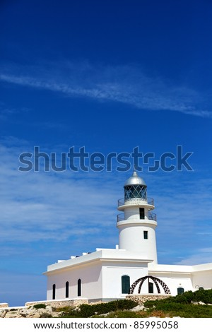 Vertical color image of a white lighthouse in a hot summer's day.