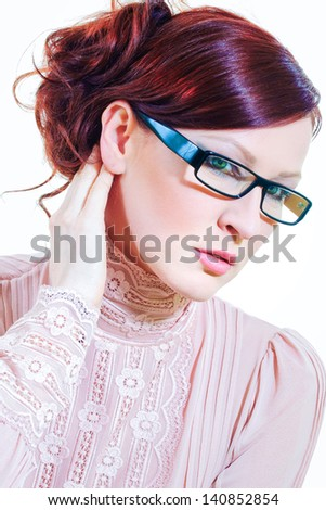 vertical color image of caucasian woman wearing trendy glasses