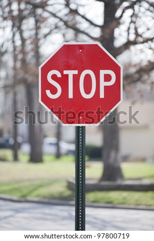 Vertical composition of stop sign on a neighborhood street.