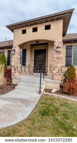 Vertical Curving front path to a front door of a house