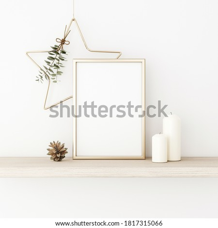 Vertical frame mockup with gold matal star, eucalyptus twigs, pine cones and candles on empty white wall background. Minimalist Christmas interior decoration. A4, A3 format. 3d rendering, illustration Сток-фото ©