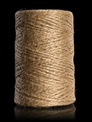 Vertical hank of jute twine it is isolated on black