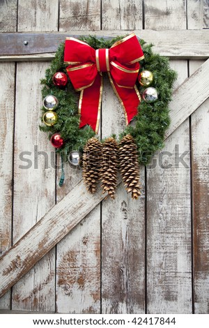 Vertical image of a Christmas wreath on a wooden door