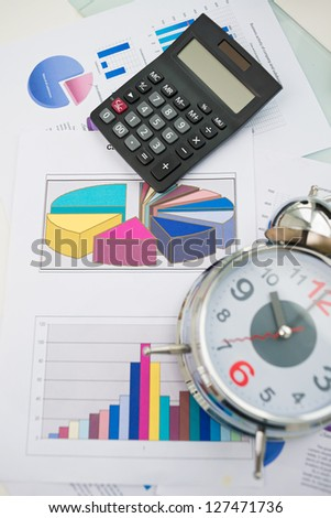 Vertical image of a group of business objects and papers