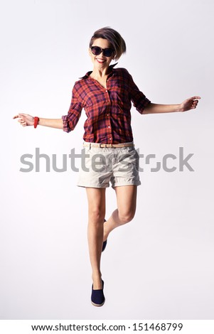 Vertical image of a modern beauty posing while jumping