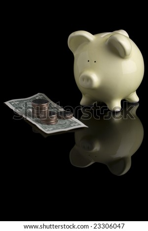 "Vertical image of a piggy bank ""looking"" at a stack of quarters with a dollar bill."