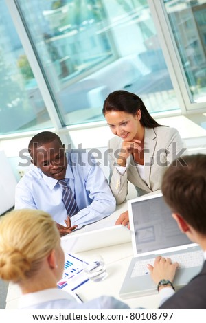 Vertical image of business team working at meeting