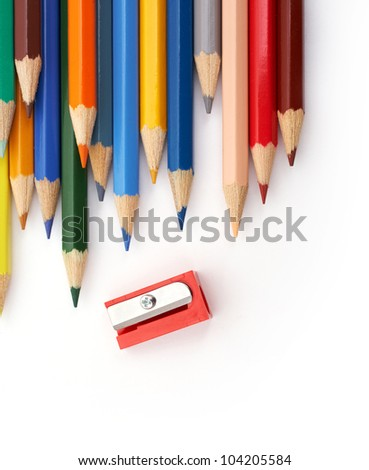 Vertical image of color pencils with a red sharpener