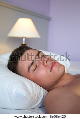 Vertical image of handsome man sleeping