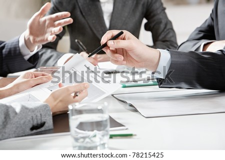 Vertical image of human hands during business discussion