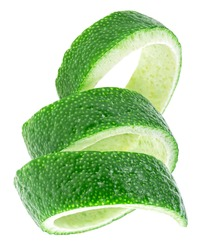Vertical image of lime fruit twist isolated on a white background. Curly lime peel twist.