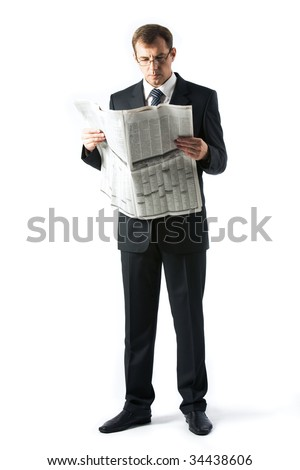 Vertical image of successful boss reading newspaper in studio