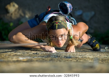 Vertical image of woman doing exercise on the mountain