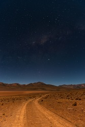 Vertical landscape at night of the North Lipez desert in the Andes mountains with the milky way galaxy near the Uyuni Salt Flat Desert, Bolivia.