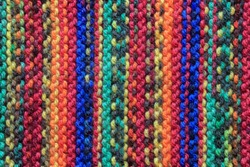 Vertical multi coloured close up knitted wool pattern
